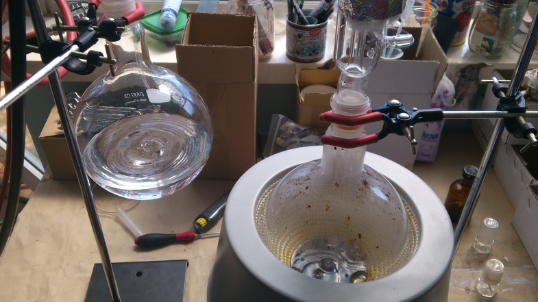 Evaporating the hexane from the soxhlet extraction product of vanilla beans. Recovered solvent (left) Vanilla oleoresin (right)