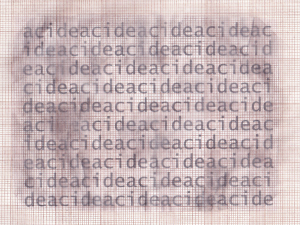 Text printed on graph paper. The blurred effect was obtained with an alcoholic solution of phenylacetic acid and a tracing paper. Surely, you can't smell it, but the odour really adds something to it.
