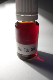 Tolu balm tincture sample displaing a nice ambery colour